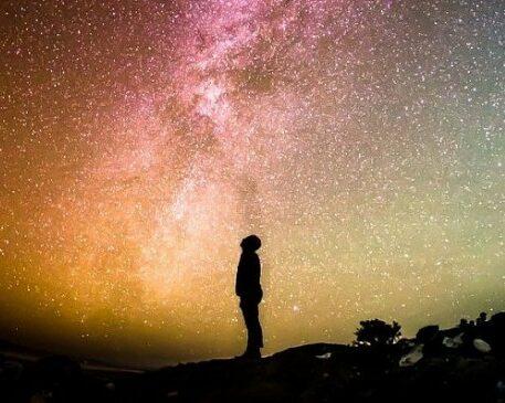 Man looking up at the heavens