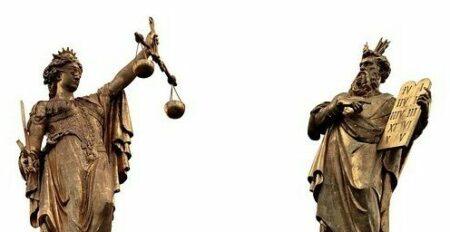 Two Greek statues judging