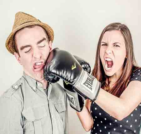 Angry woman boxing a man