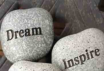 Dream and inspire written on stones