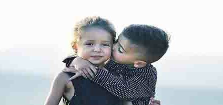 young boy kissing young girl
