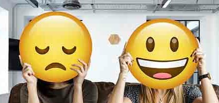 Woman with sadface and woman with smiley face