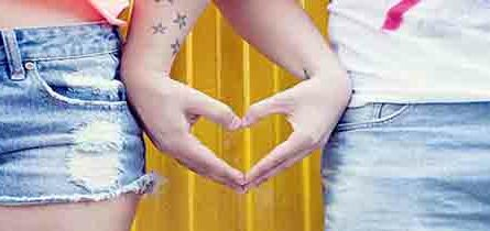 Girl and boy s hands joined in heart shape
