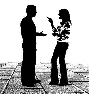 woman pointing finer at man while arguing