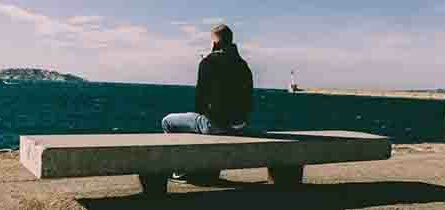 Man sitting on bench thinking about life