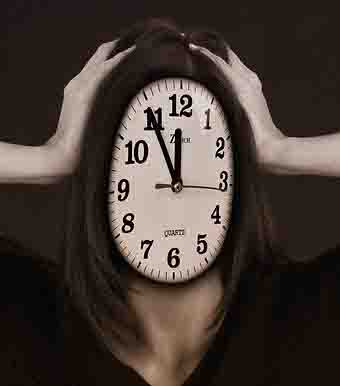 Stressed woman witha clock for a face
